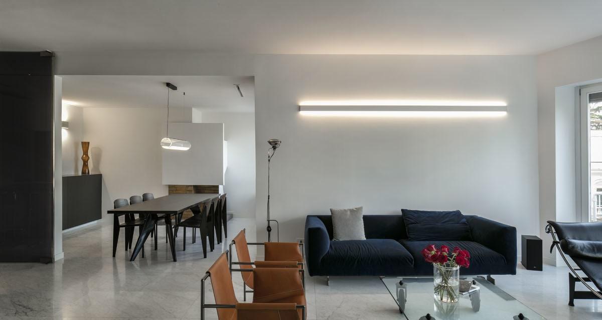 _arredo e illuminazione dal design minimal ed elegante, colori caldi e tessuti morbidi.